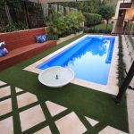 """Bellagio"" Fiberglass Inground Swimming Pool, pictured as backyard pool"