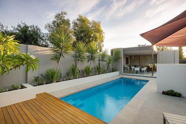 """Harmony"" Medium Fiberglass Swimming Pool (pictured as backyard pool)"