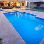"Fiberglass Swimming Pool ""Imperial "" (Medium Pool) by Aqua Technics Pools, pictured as backyard pool"